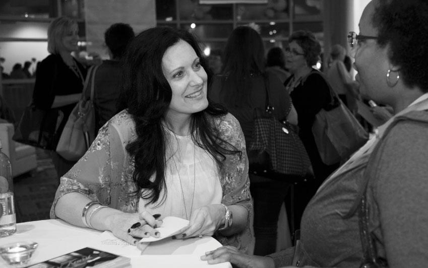Lysa TerKeurst signing books.
